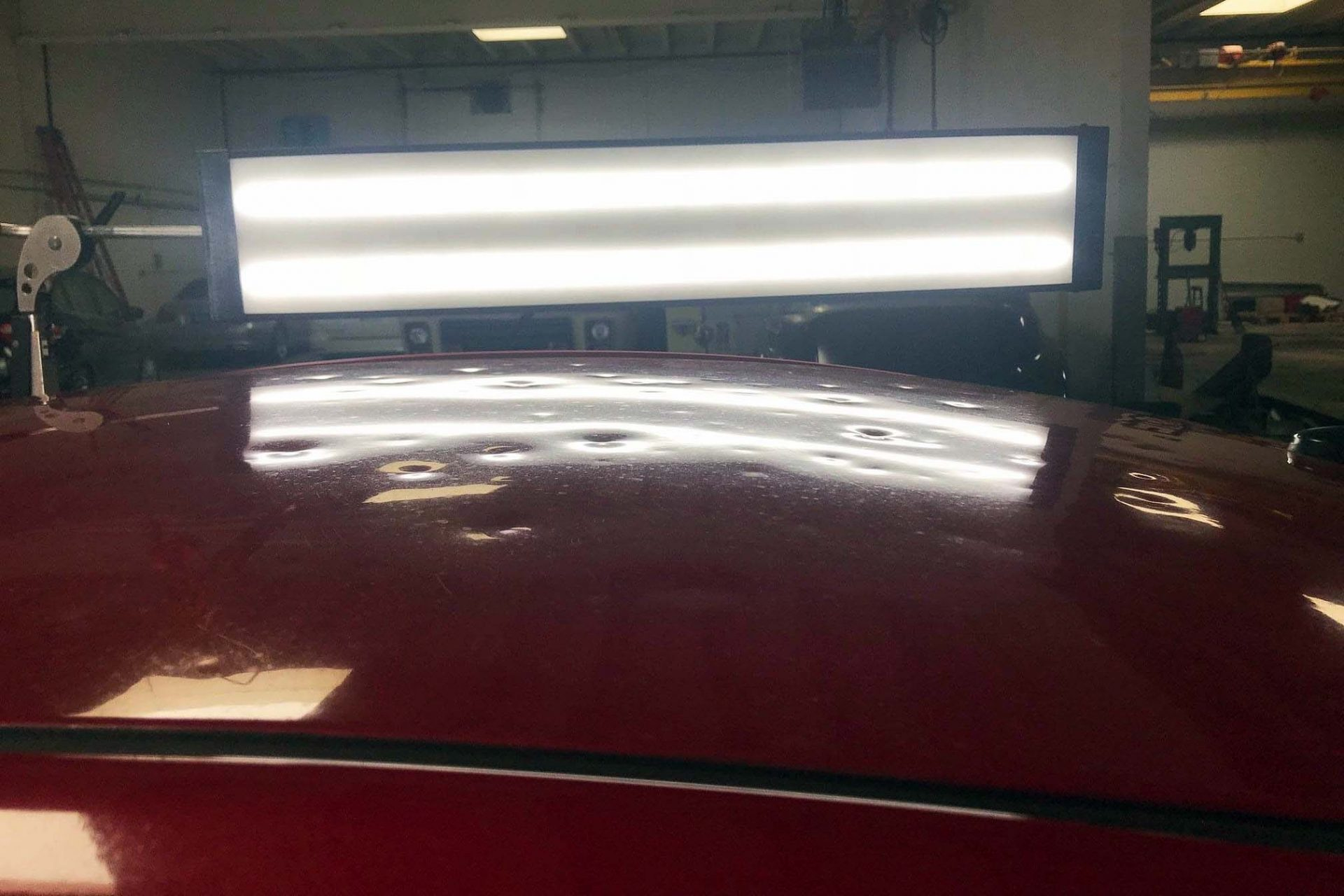 Paintless Dent Repair by Wilmette Auto Body from Hail Damage Before Image
